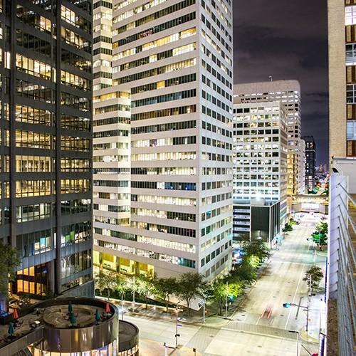 City Street and Houston High Rises at Night - Houston, Texas, US